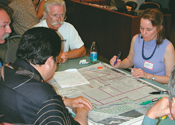 people meeting to review plans